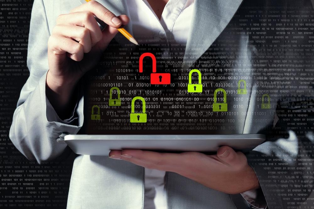 Businesswoman holding tablet entering password
