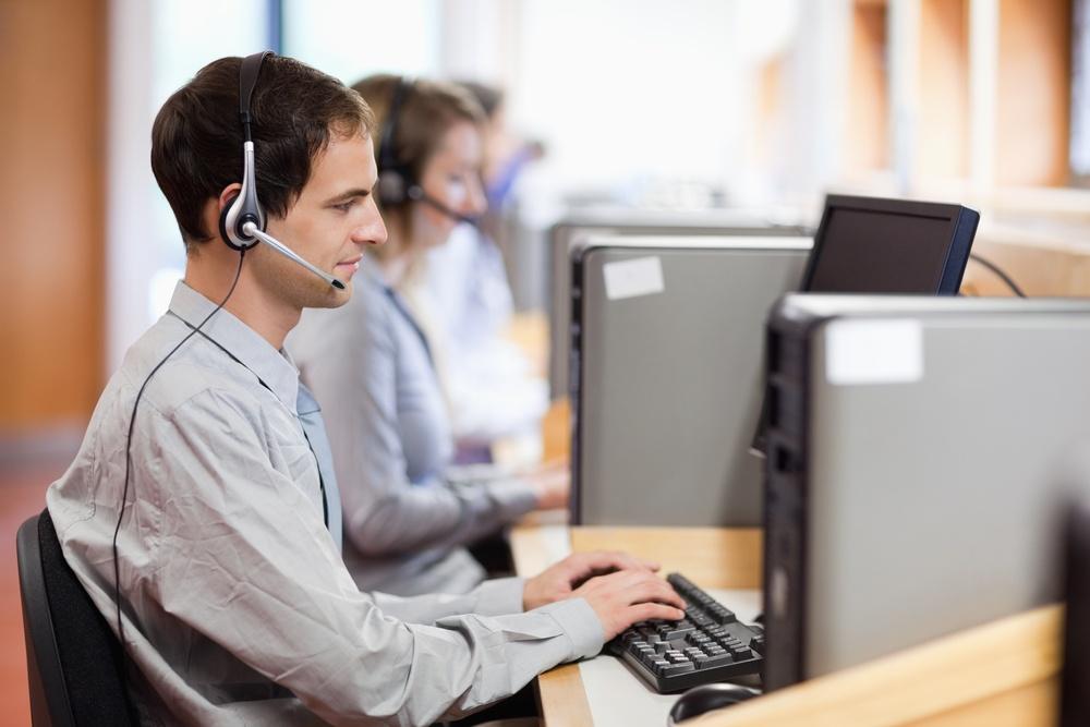 Help desk technician working at computer