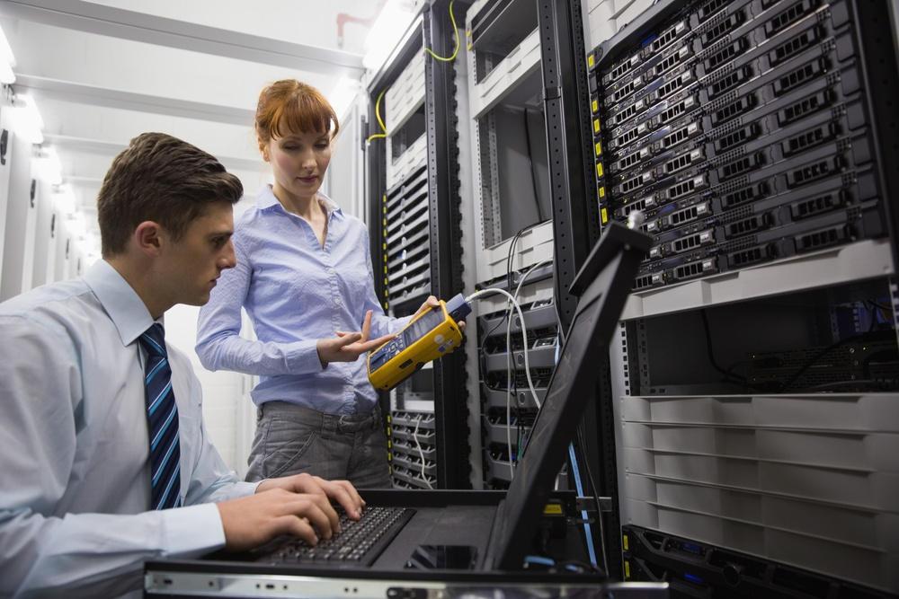 Network engineers working together on servers